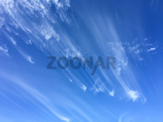 Windswept clouds and blue sky