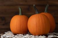 Pumpkins and seeds on wood