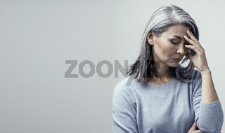 Asian woman in distress on white background