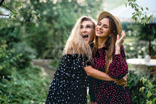 Two girls in a summer park