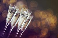 Champagne glasses on lights background