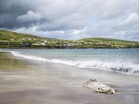 Waves on the sandy beach of ventry on dingle peninsula
