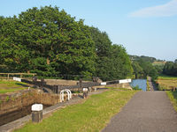 a canal and lock gates in west yorkshire scenery in the calder valley near luddenden