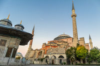Hagia Sophia domes and minarets in the old town of Istanbul, Turkey, at sunrise.