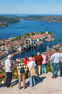 Tourists looking out over the city Bergen in Norway
