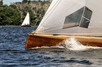 classic sailing yacht on a lake in a regatta