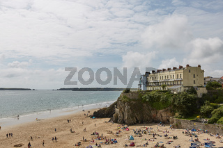 People on beach in Tenby, Wales, UK