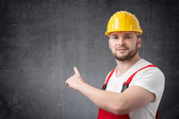 Worker holding pointing at the wall