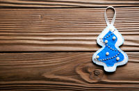Handmade rustic felt Christmas tree decorations on wooden table