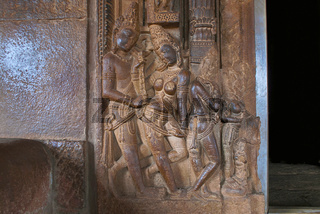 Carved figures on the left side of the entrance door to the garbh griha main shrine , Durga temple, Aihole, Bagalkot, Karnataka. The Galaganatha Group of temples.