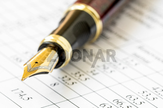 Fountain-pen on a financial report