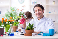 Two young botanist working in the lab