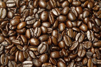 close-up roasted coffee beans, can be used as a background texture