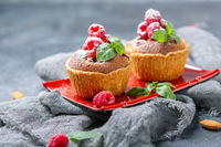 Tartlets with red raspberries and frangipani.