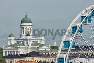Ferris wheel and Cathedral of the Diocese of Helsinki, finnish Evangelical Lutheran church, located in the neighborhood of Kruununhaka in Helsinki, Finland