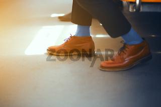 Feet of businessman at metro station.