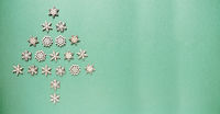 Wooden Snowflakes Building A Christmas Tree, Green Paper Background