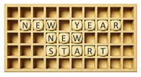 a wooden grid with cubes new year new start
