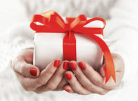 Small gift box in hands