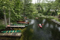 Stakboote und Kanus auf der Krutinia
