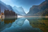 Mountains reflected in water in beautiful lake at sunny morning