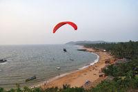ANJUNA BEACH, GOA, INDIA, December 2008, Tourist perform Paragliding activity.