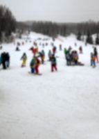 Ski slope with a lot of athletes in winter