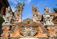 Statues on a temple entrance door, Ubud, Bali, Indonesia