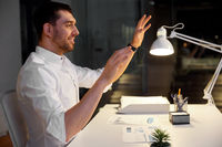businessman using gestures at night office
