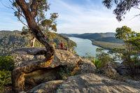 Woman chillaxing with river views in Australian bushland