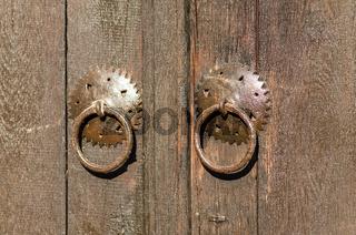 Old metal padlock on a wooden door. Historical village Bojenci, Gabrovo, Bulgaria.