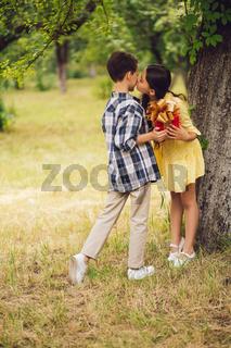 Little boy giving present to little girl.