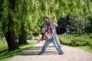 Adorable father and daughter have fun together