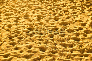 Sandy beach with footprints
