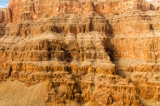 aerial view of grand canyon cliffs from helicopter