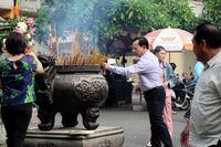 Man pray, burn incense