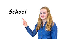 Female pupil points to word School on whiteboard