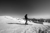 Skier on top of snowy ski slope