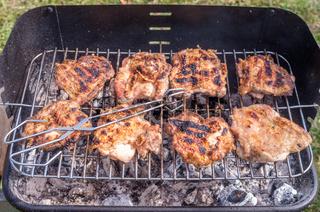 Grilling chicken, chicken steak on the grill.
