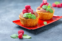 Raspberry tartlets with almond cream and mint.