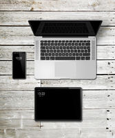 Laptop, tablet and phone set mockup on a wooden background. 3D render