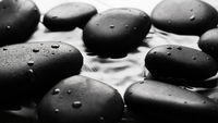Grey wet pebbles background wallpaper