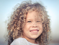 Portrait of a smiling little girl.