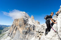 young attractive blonde female mountain climber in the Dolomites of Italy
