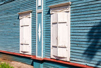 Wooden shutters on the windows of the old house