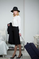Young businesswoman with a suitcase