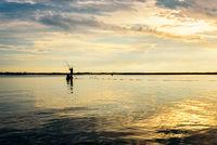 Fisherman on the boat use fishing nets at sunrise, Thailand