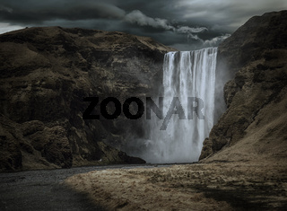 Majestic and dark Skogafoss waterfall in Iceland
