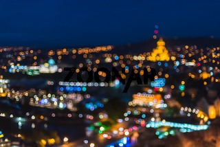 Blur blue night view of city lights with bright circle shape bokeh