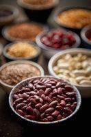 Raw red bean in ceramic bowl. Selective focus